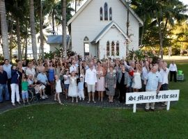 Wedding party outside St Mary's chapel on the beach, Port Douglas