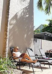 Relaxing poolside at Nautilus Apartments Port Douglas